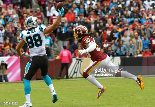 Carolina Panthers tight end Greg Olsen reaches back for a pass in the fourth quarter against Washington Redskins free safety DJ Swearinger Sr on...