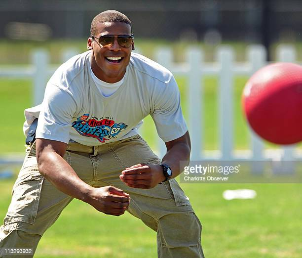 Carolina Panthers top draft choice Cam Newton keeps his eyes on the ball as he prepares to field a ball during teammate Jordan Gross' charity...