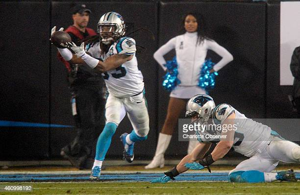 Carolina Panthers' Tre Boston intercepts an Arizona Cardinals pass deflected by Luke Kuechly during the fourth quarter in NFC Wild Card playoff...