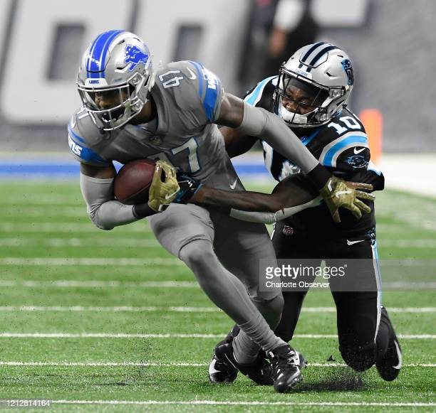 Carolina Panthers wide receiver Curtis Samuel tries to grab the ball after Detroit Lions defensive back Tracy Walker intercepted the pass during the...