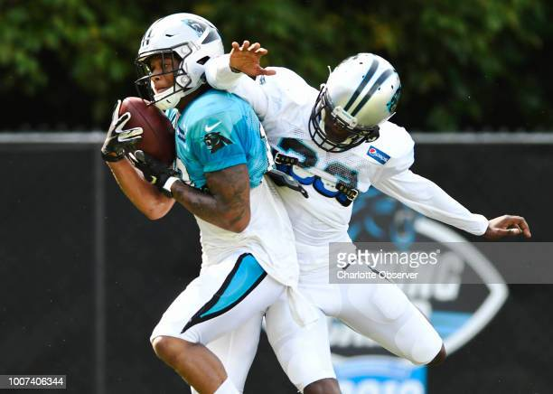 Carolina Panthers wide receiver DJ Moore makes a reception past cornerback LaDarius Gunter during practice at training camp at Wofford College in...