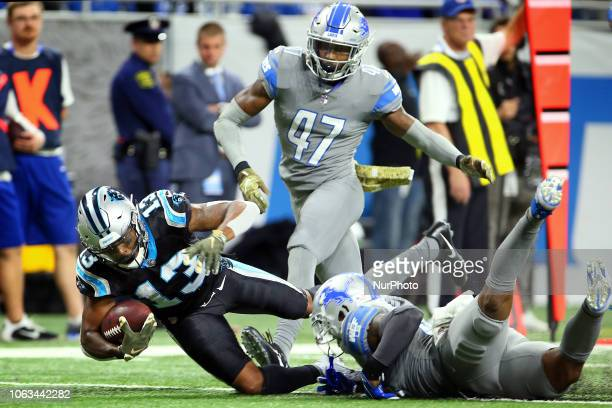 Carolina Panthers wide receiver Jarius Wright is sacked by Detroit Lions defensive back Tavon Wilson during the second half of an NFL football game...