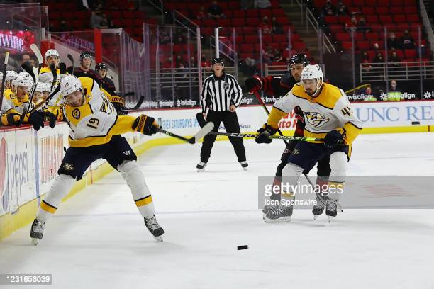 Carolina Panthers wide receiver Keith Kirkwood shoots the puck during the 2nd period of the Carolina Hurricanes vs Nashville Predators on March 11th,...