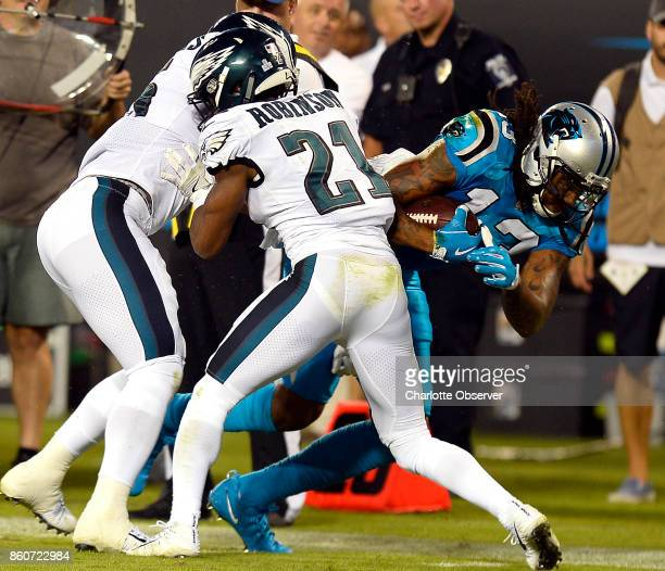 Carolina Panthers wide receiver Kelvin Benjamin stretches for extra yardage past Philadelphia Eagles defensive back Patrick Robinson in the first...