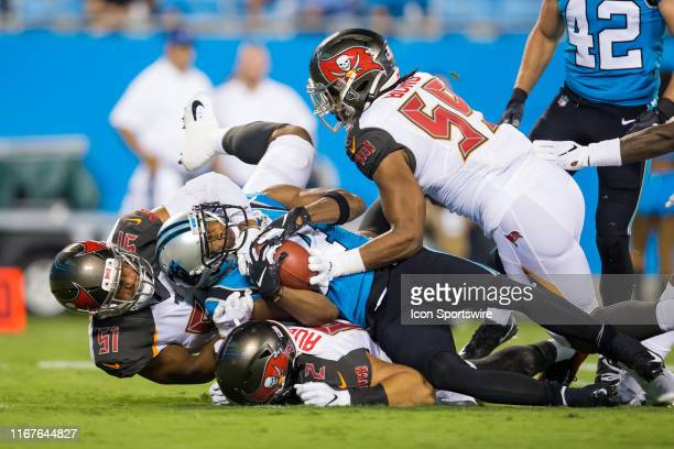 Carolina Panthers wide receiver Ray-Ray McCloud is tackled by Tampa Bay Buccaneers linebacker Kevin Minter , linebacker Devante Bond , and tight end...