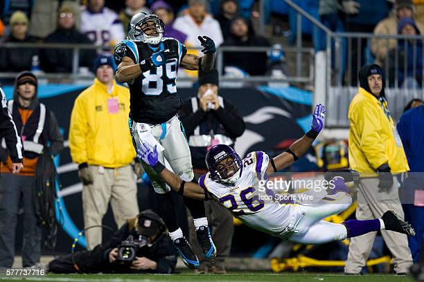 Carolina Panthers wide receiver Steve Smith looks to catch a pass against Minnesota Vikings cornerback Antoine Winfield during an NFL football game...