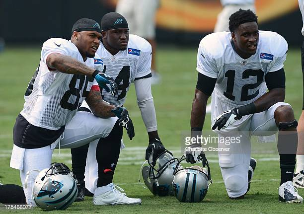 Carolina Panthers wide receivers, from left, Steve Smith, Armanti Edwards and David Gettis gather during the team's Fan Fest practice at Bank of...
