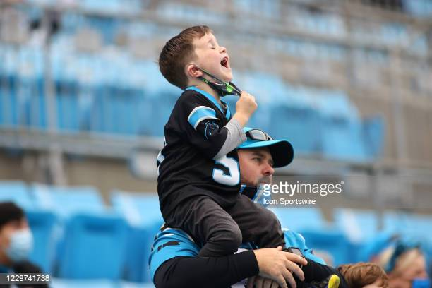 Carolina Panthers younger fan shouts during 2nd half of the Carolina Panthers versus the Detroit Lions on November 22 at Bank of America Stadium in...