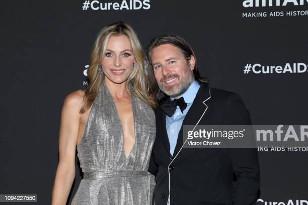 Carolina Parsons and Rodman Primack pose during the amfAR gala dinner at the house of collector and museum patron Eugenio López on February 5 2019 in...