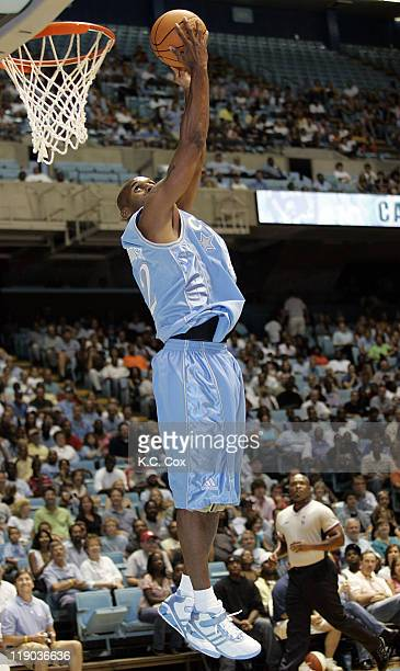 Carolina Pro Jerry Stackhouse dunks during the 4th Annual World's Greatest Alumni Basketball Game Saturday August 27 at the Dean E Smith Center in...