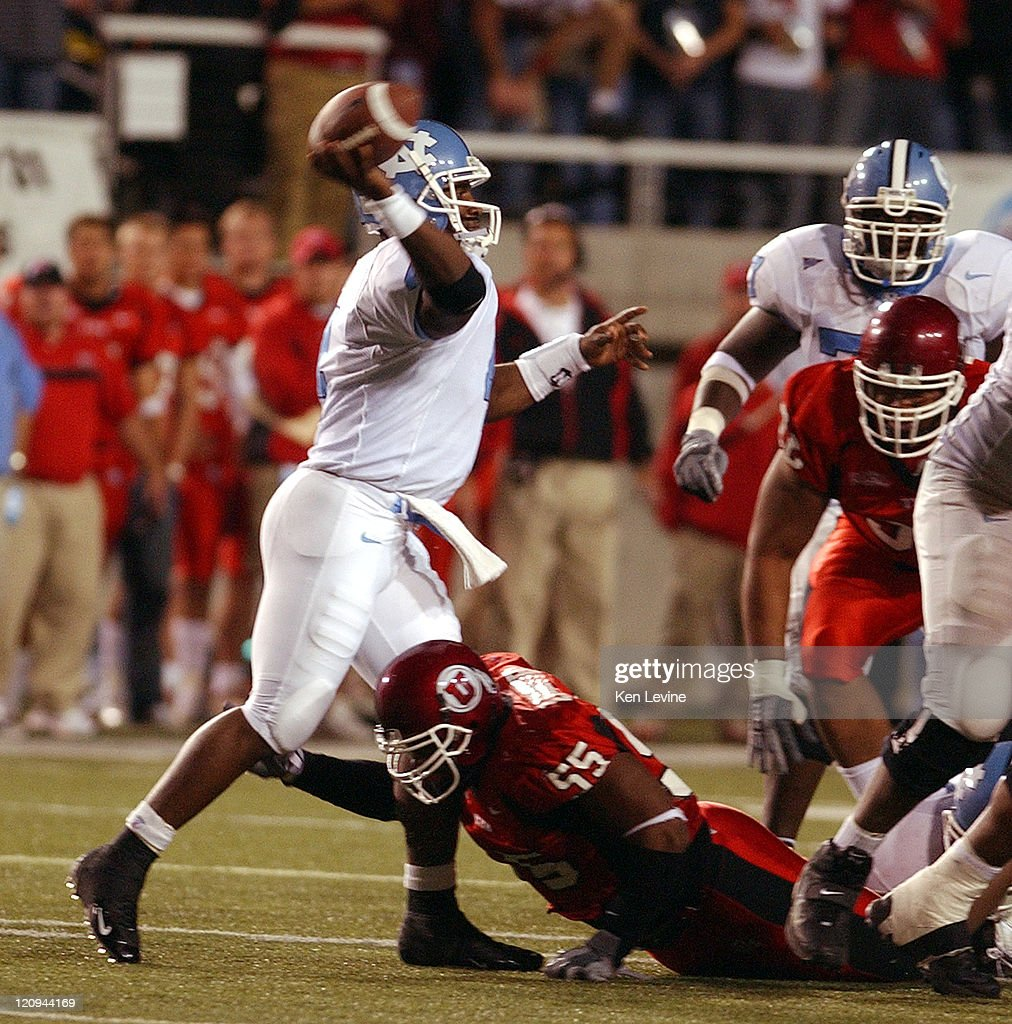 N. Carolina quarterback Darian Durant (4) gets off a pass while being pressured by Utahs Andrew Johnson (55) during the first quarter Saturday, Oct. 16, 2004 at Rice-Eccles Stadium in Salt Lake City, Utah. Utah defeated N. Carolina 46-16.