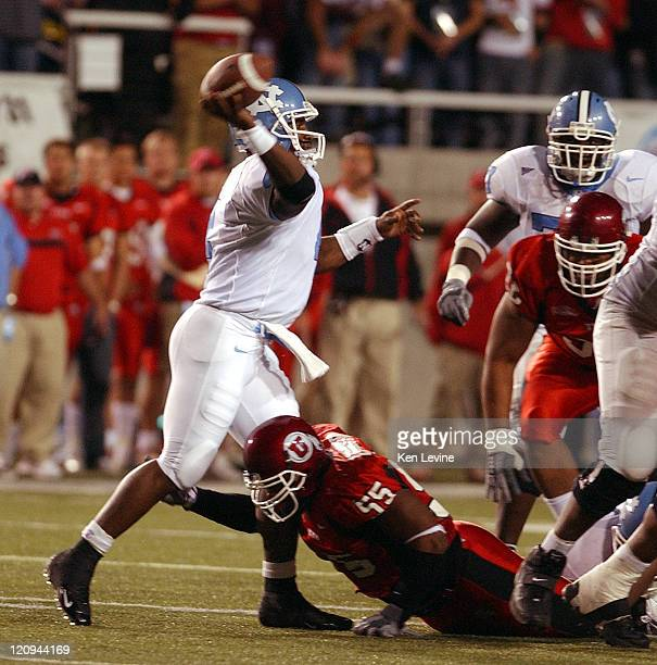Carolina quarterback Darian Durant gets off a pass while being pressured by Utahs Andrew Johnson during the first quarter Saturday, Oct. 16, 2004 at...