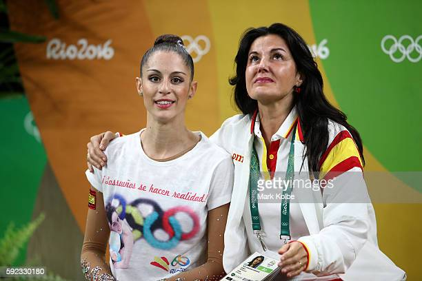 Carolina Rodriguez of Spain waits for her score with her coach during the Women's Individual AllAround Rhythmic Gymnastics Final on Day 15 of the Rio...
