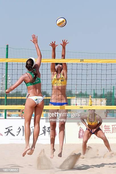 Carolina Solberg Salgado of Brazil in action during the 2013 FIVB World Tour Xiamen Grand Slam women MD Games match against Tatyana Mashkova of...