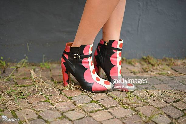 Carolina Stigliano poses wearing Valentino shoes before the MSGM show during the Milan Fashion Week Spring/Summer 16 on September 27 2015 in Milan...