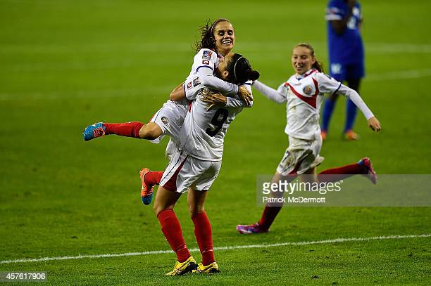 Carolina Venegas of Costa Rica celebrates with her teammate Katherine Alvarado after scoring a goal in the second half of a game against Martinque...