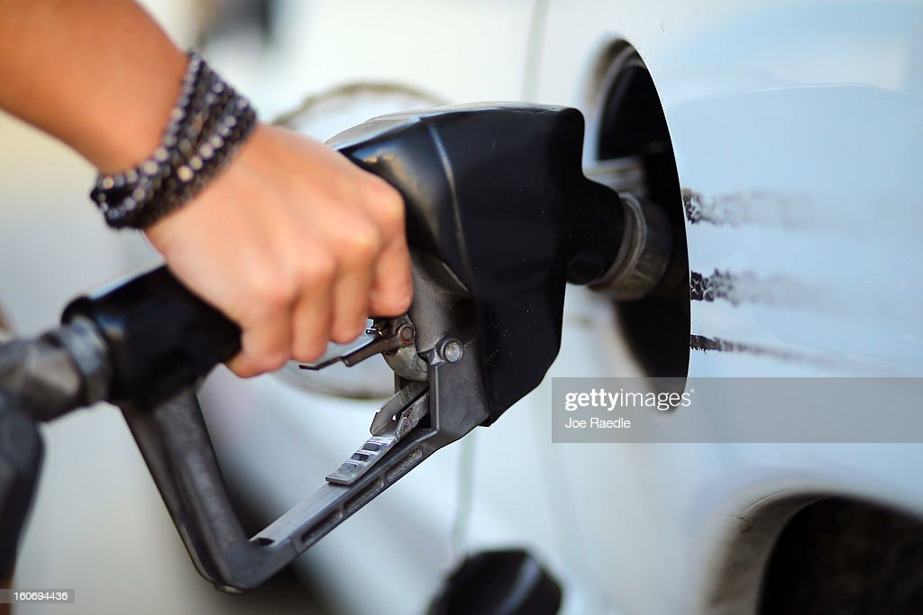 Carolina Villar pumps gas on February 4, 2013 in Miami, Florida. Reports indicate that gas pump prices are at their highest level on record for this period of the year and may be an indication that the year ahead may see even higher records.