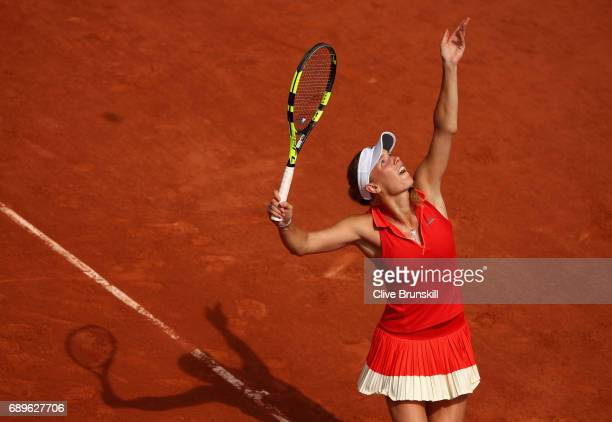 Carolina Wozniacki of Denmark serves during the ladies singles first round match against Jaimee Fourlis of Australia on day two of the 2017 French...