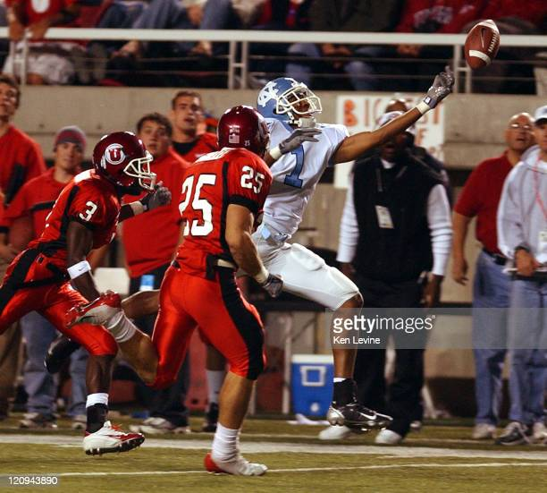 Carolinas' Derrele Mitchell can't make a finger tip catch on a pass during the second quarter as Utah defenders Gerald Fletcher and Morgan Scalley...