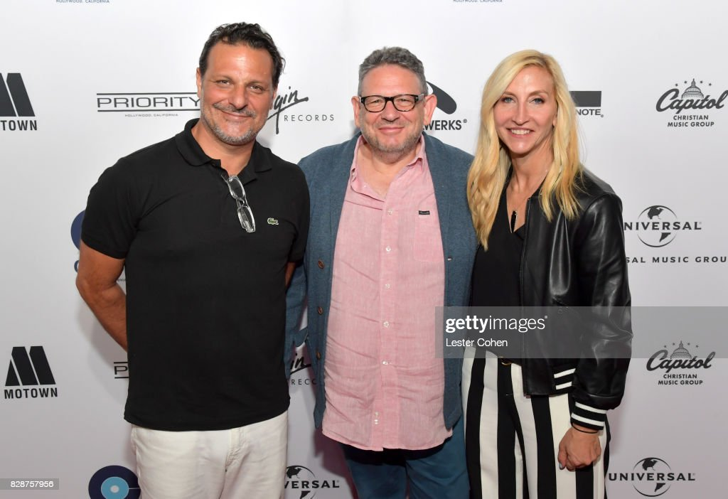 Caroline and Harvest Records Co-General Manager Piero Giramonti, Chairman and Chief Executive Officer of Universal Music Group Lucian Grainge and Caroline and Harvest Records Co-General Manager Jacqueline Saturn attend Capitol Music Group's Premiere Of New Music And Projects For Industry And Media at ArcLight Cinemas on August 9, 2017 in Hollywood, California.