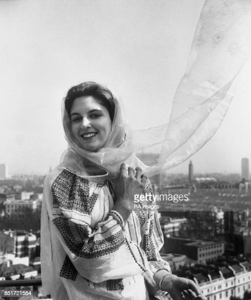 Caroline Band, of Folkestone, Kent, models a hand-worked Romanian peasant blouse and scarf, which will be among the features of the exhibition of...