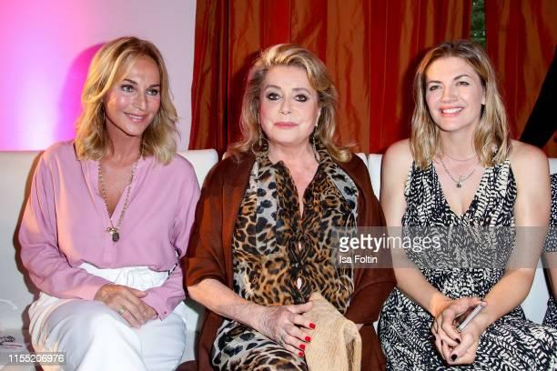 Caroline Beil Catherine Deneuve and Nina Bott during the Ernsting's family Fashion Show 2019 on July 11 2019 in Hamburg Germany