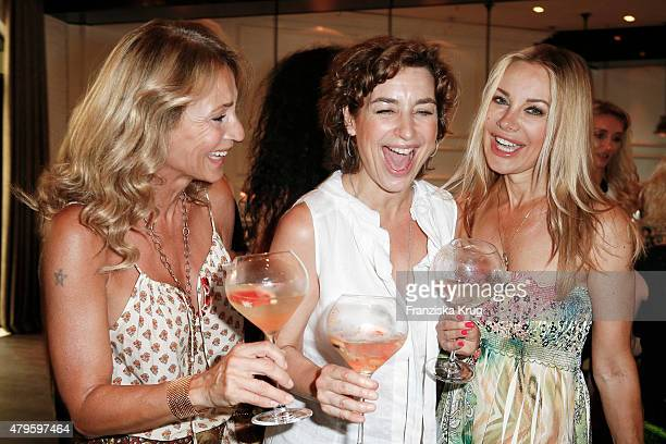 Caroline Beil Isabel Varell and Xenia Seeberg attend the Wanawake Ladies Dinner at Hotel Zoo on July 05 2015 in Berlin Germany