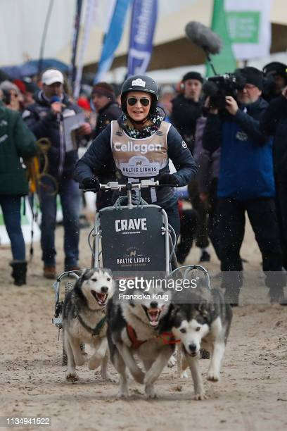 """March 09: Caroline Beil participates in the sled dog race as part of the """"Baltic Lights"""" charity event on March 9, 2019 in Heringsdorf, Germany. The..."""