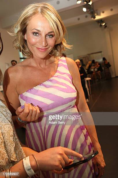 Caroline Beil tries out a Blackberry Z10 smartphone at the Blackberry Style Lounge during MercedesBenz Fashion Week in Berlin on July 3 2013 in...
