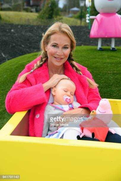 Caroline Beil with her daughter Ava Beil test the new kids area 'Peppa Pig Land 'at Heide Park Resort theme park on April 4, 2018 in Soltau, Germany.