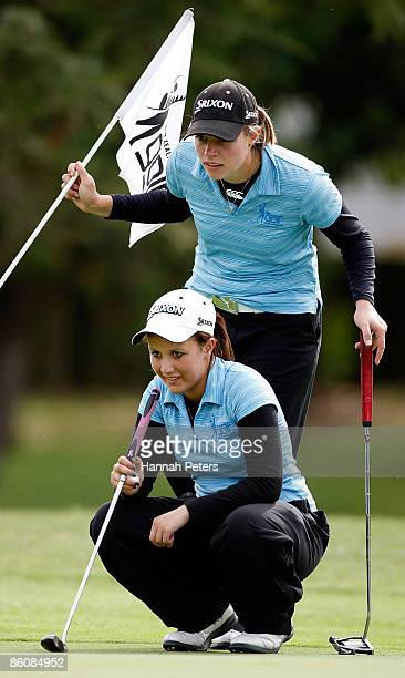 Caroline Bon of Northland and Larissa Eruera of Aviation line up a putt on the ninth hole during the New Zealand Women's Amateur Championship at...