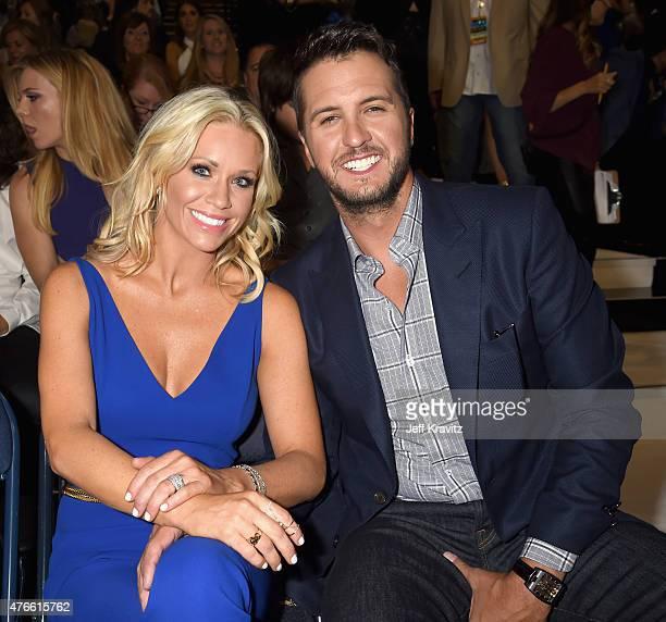 Caroline Boyer and Luke Bryan attend the 2015 CMT Music awards at the Bridgestone Arena on June 10 2015 in Nashville Tennessee