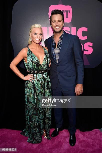 Caroline Boyer and Luke Bryan attend the 2016 CMT Music awards at the Bridgestone Arena on June 8 2016 in Nashville Tennessee