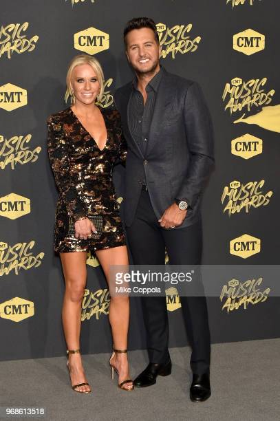 Caroline Boyer and Luke Bryan attend the 2018 CMT Music Awards at Bridgestone Arena on June 6 2018 in Nashville Tennessee