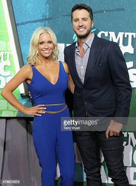 Caroline Boyer and Luke Bryan attendthe 2015 CMT Music awards at the Bridgestone Arena on June 10 2015 in Nashville Tennessee