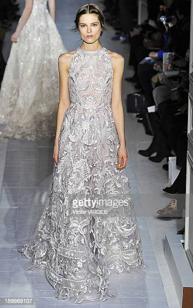 Caroline Brasch Nielsen walks the runway during the Valentino Spring/Summer 2013 HauteCouture show as part of Paris Fashion Week at Hotel Salomon de...