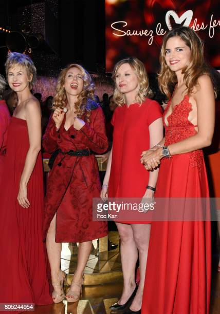 Caroline Bresard, Cyrielle Hariel, Karine De Menonville and Margaux De Frouville attend the 'Red Defile' Auction Fashion Show Hosted by Ajila...