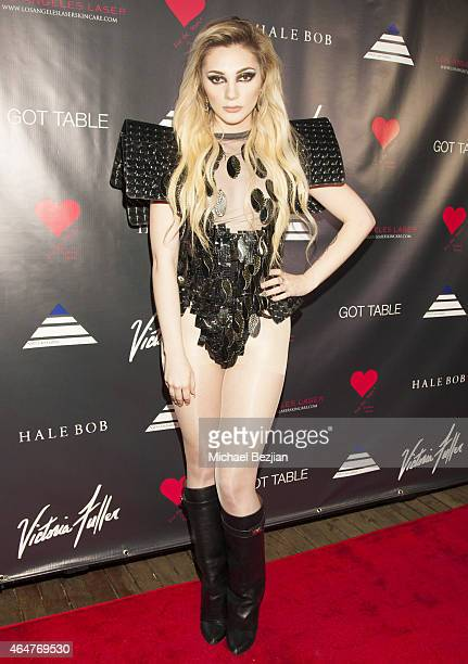 Caroline Burt attends Caroline Burt DJs At Victoria Fuller's The Beauty Code Art Show at The Redbury Hotel on February 25 2015 in Hollywood California