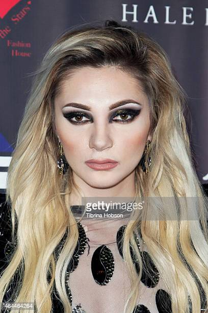 Caroline Burt attends Victoria Fuller's 'The Beauty Code' art show at The Redbury Hotel on February 25 2015 in Hollywood California
