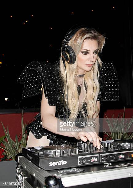 Caroline Burt performs at Victoria Fuller's 'The Beauty Code' art show at The Redbury Hotel on February 25 2015 in Hollywood California