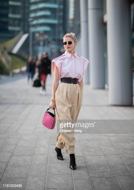 Caroline Caro Daur is seen wearing beige pants pink top Prada bag outside Alberta Ferretti on Day 1 Milan Fashion Week Autumn/Winter 2019/20 on...