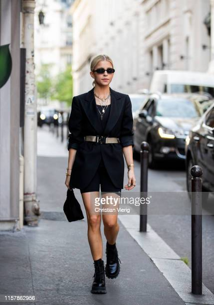 Caroline Caro Daur is seen wearing black belted blazer cycle pants outside Alyx during Paris Fashion Week Menswear Spring/Summer 2020 on June 23 2019...