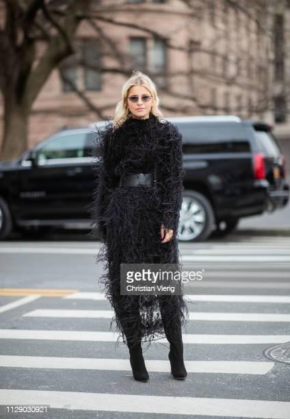 Caroline Caro Daur is seen wearing black belted fluffy coat outside Carolina Herrera during New York Fashion Week Autumn Winter 2019 on February 11...
