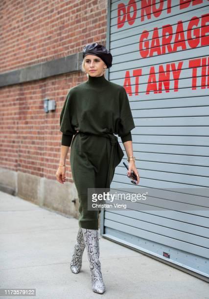 Caroline Caro Daur is seen wearing black beret green dress boots with snake print outside Zimmermann during New York Fashion Week September 2019 on...