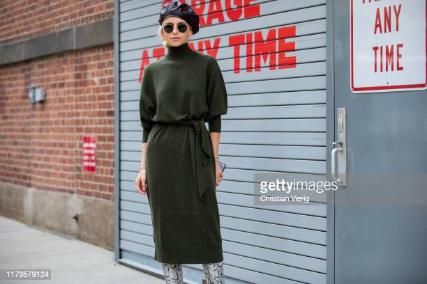 Caroline Caro Daur is seen wearing black beret, green dress, boots with snake print outside Zimmermann during New York Fashion Week September 2019 on...