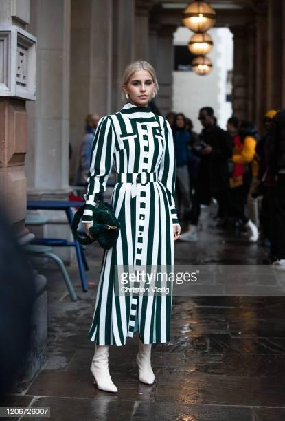 Caroline Caro Daur is seen wearing black white striped dress, green bag outside Emilia Wickstead during London Fashion Week February 2020 on February...