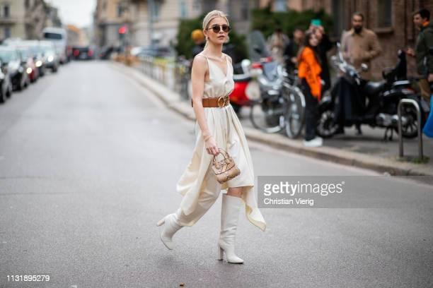 Caroline Caro Daur is seen wearing dress with belt outside Ferragamo on Day 4 Milan Fashion Week Autumn/Winter 2019/20 on February 23 2019 in Milan...
