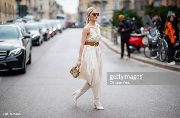 Caroline Caro Daur is seen wearing dress with belt outside Ferragamo on Day 4 Milan Fashion Week Autumn/Winter 2019/20 on February 23 2019 in Milan...