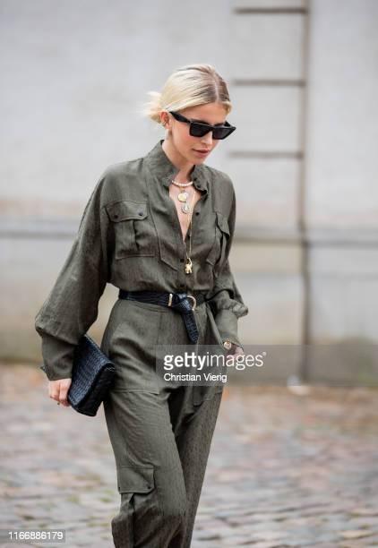 Caroline Caro Daur is seen wearing green belted overall black bag outside Lala Berlin during Copenhagen Fashion Week Spring/Summer 2020 on August 08...