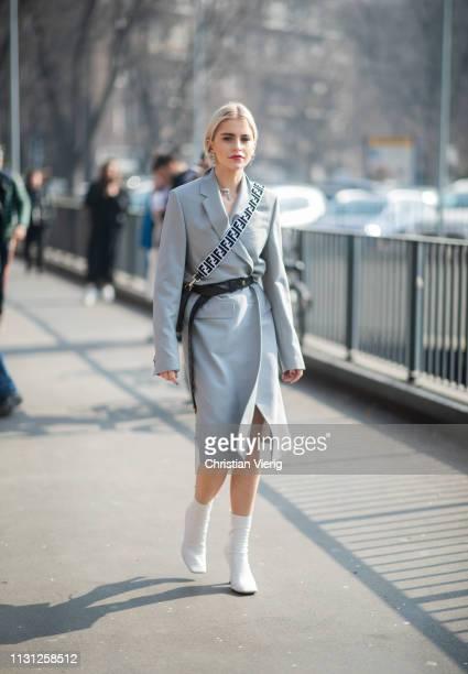 Caroline Caro Daur is seen wearing grey coat bag outside Fendi on Day 2 Milan Fashion Week Autumn/Winter 2019/20 on February 21 2019 in Milan Italy
